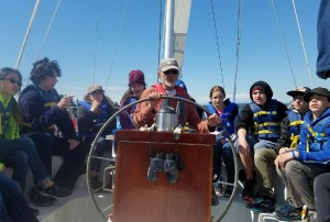 Captain Thom at the helm