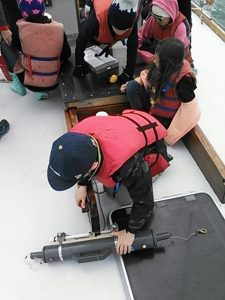 Science on the bow. Preparing the niskin bottle.