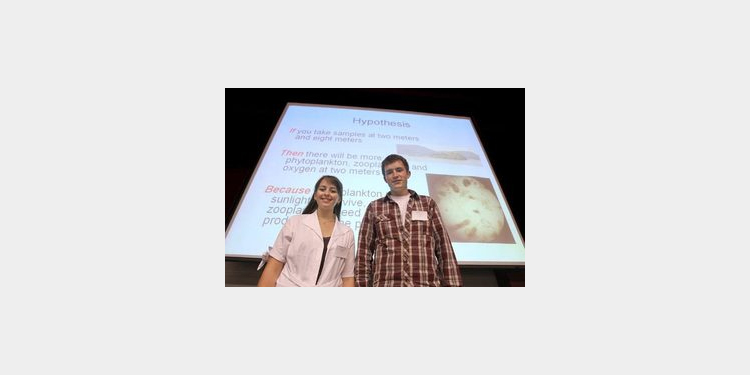 Two students from Mt. Si High School, Krystal Stewart and Dylan Glaser, gave a PowerPoint presentation of their research gathered on a Salish Sea Expedition at a symposium of science students in Seattle.